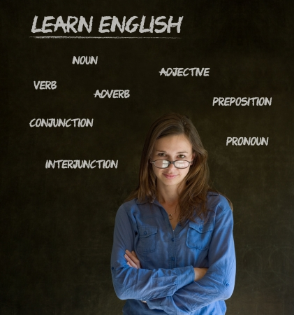 Learn English confident beautiful woman teacher chalk blackboard background Stock Photo - 19049086