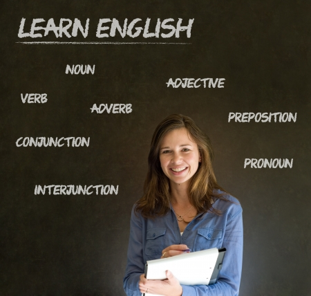 Learn English confident beautiful woman teacher chalk blackboard background photo