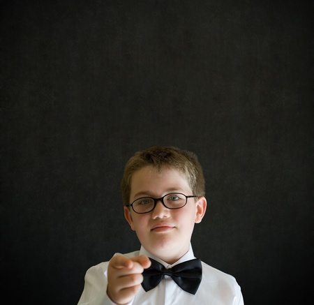 Your child or children need you boy dressed up as business man, teacher or student on blackboard background photo