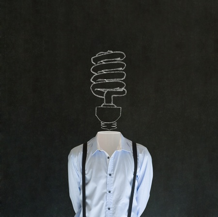 Headless bright environmental idea business man,  teacher or student with chalk background lightbulb head