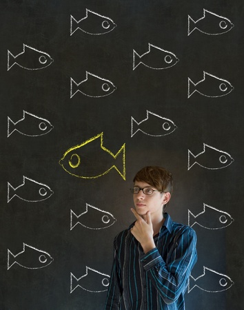 Independent thinking business man, student or teacher with fish swimming against the flow