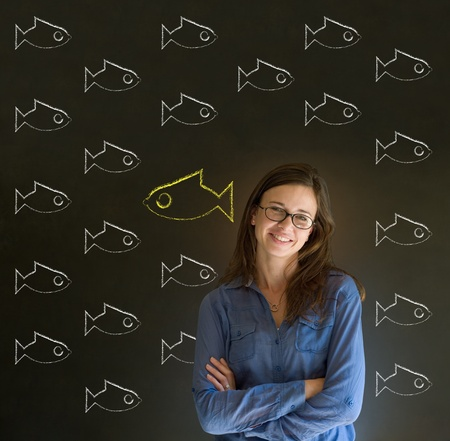 against the flow: Independent thinking business woman, student or teacher with fish swimming against the flow Stock Photo
