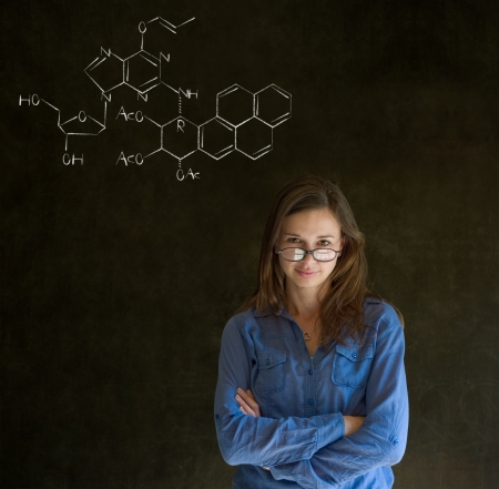 chemistry lesson: Learn science or chemistry formula confident beautiful woman teacher chalk blackboard background