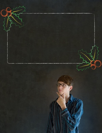 Business man, student or teacher with Christmas holly to do checklist on blackboard background Stock Photo - 19286672