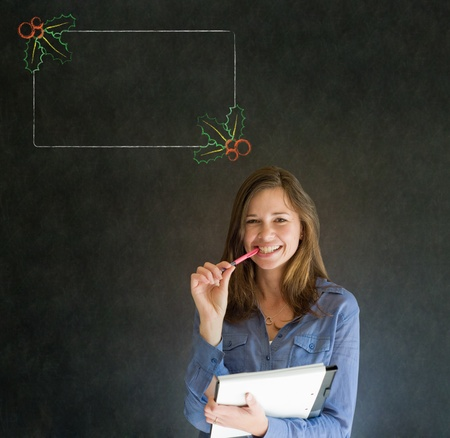 Business woman, student or teacher with Christmas holly to do checklist on blackboard background photo