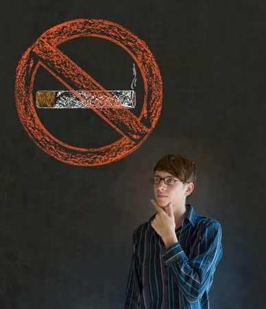 No smoking tobacco addict business man, student or teacher on blackboard background photo