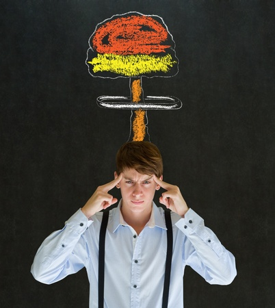 Business man, student or teacher with thought thinking chalk nuclear bomb cloud on blackboard background Stock Photo - 19286729