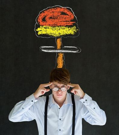 Business man, student or teacher with thought thinking chalk nuclear bomb cloud on blackboard background photo