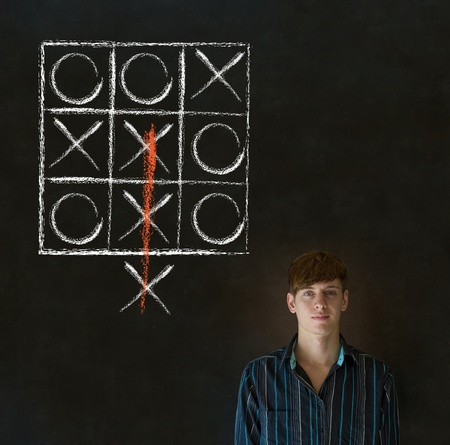 tic tac toe: Thinking out of the box businessman, student or teacher tic tac toe on blackboard background