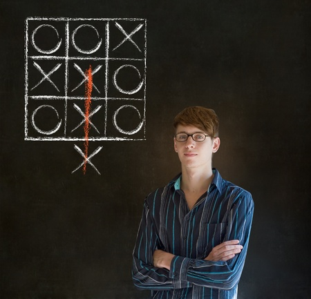 Thinking out of the box businessman, student or teacher tic tac toe on blackboard background photo