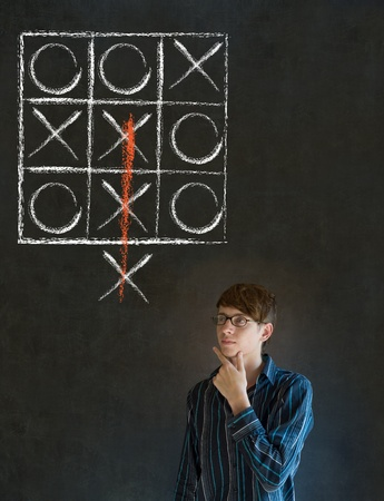 think out of the box: Thinking out of the box businessman, student or teacher tic tac toe on blackboard background