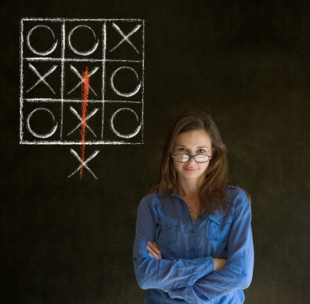 tic tac toe: Thinking out of the box businesswoman, student or teacher tic tac toe on blackboard background
