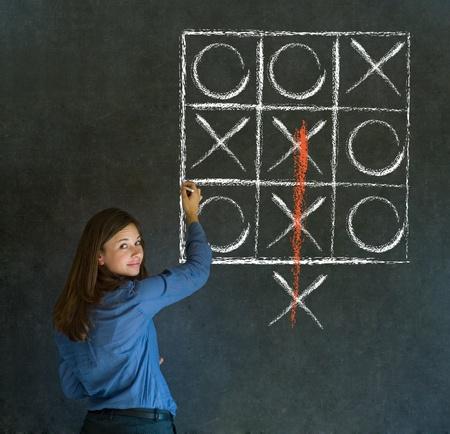 thinking out of the box: Thinking out of the box businesswoman, student or teacher tic tac toe on blackboard background