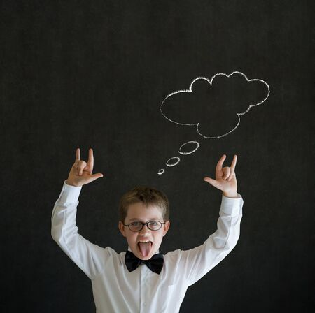 Education rocks boy dressed up as business man with thought thinking chalk cloud on blackboard background photo