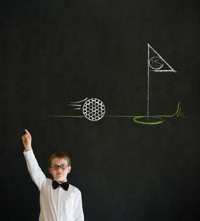 Hand up answer boy dressed up as business man with chalk golf ball flag green on blackboard background Stock Photo - 19727494