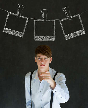 Businessman, teacher or student with chalk instant photograph style photographs on clothes line blackboard background photo