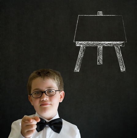 Education needs you thinking boy dressed up as business man with learn art chalk easel on blackboard background photo