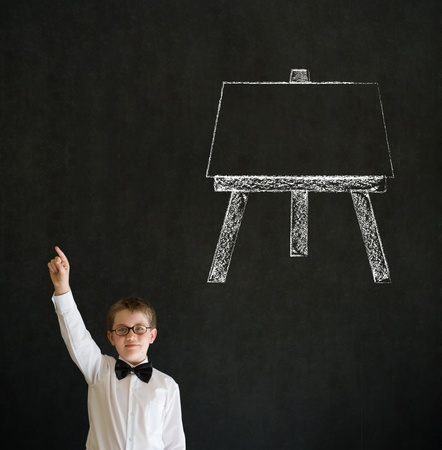 Hand up answer boy dressed up as business man with learn art chalk easel on blackboard background photo