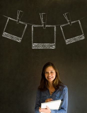 Businesswoman, teacher or student with chalk polaroid style photographs on clothes line blackboard background photo