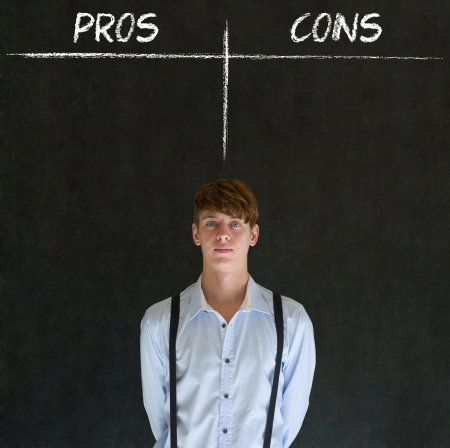 Businessman, student or teacher thinking pros and cons decision list chalk concept blackboard background Stock Photo - 20618088