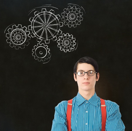 Nerd geek businessman, student or teacher with chalk thinking turning gear cogs or gears on blackboard background Stock Photo - 20618110