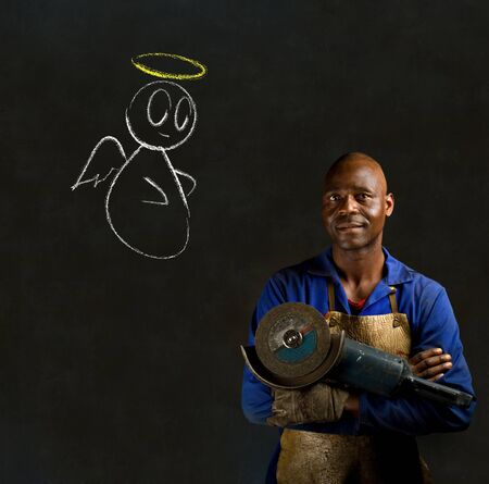 African black man industrial worker with chalk angel on blackboard background photo