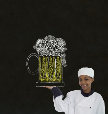 Woman female African or African American chef holding beer drink on chalk blackboard background photo