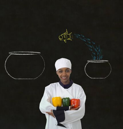 Woman female African or African American chef jumping fish decision on chalk blackboard background photo