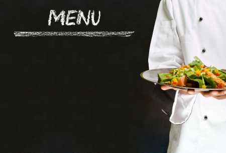 organic peppers sign: Chef with healthy salad food on chalk blackboard menu writing background Stock Photo