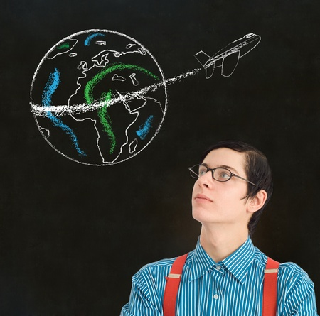Nerd geek businessman student teacher with chalk globe and jet world travel blackboard background photo