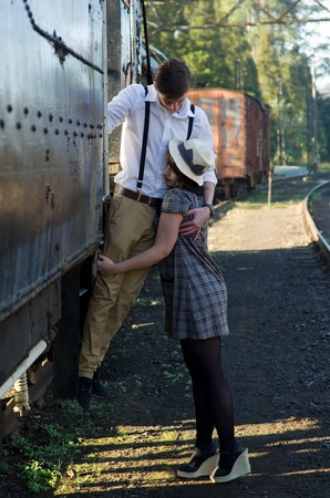 Retro hip hipster romantic love couple in vintage train setting photo