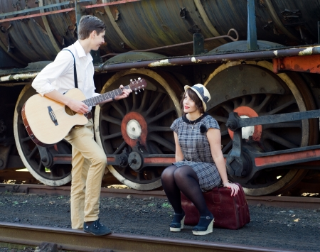 Retro hip hipster romantic love couple serenade  vintage train setting photo