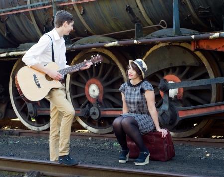 life partner: Retro hip hipster romantic love couple serenade  vintage train setting