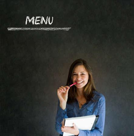 staff training: Businesswoman, restaurant owner or chef with chalk menu sign blackboard background Stock Photo