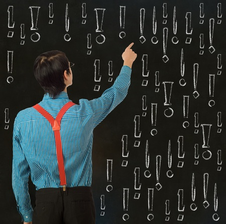 Nerd geek businessman, student or teacher with chalk exclamation marks on blackboard background Stock Photo - 21993776