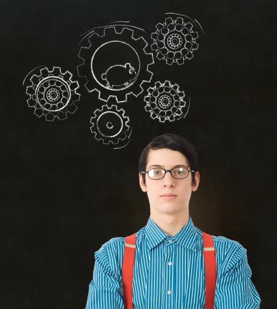 thinks: Nerd geek businessman, student or teacher with chalk running hamster thinking turning gear cogs or gears on blackboard background Stock Photo
