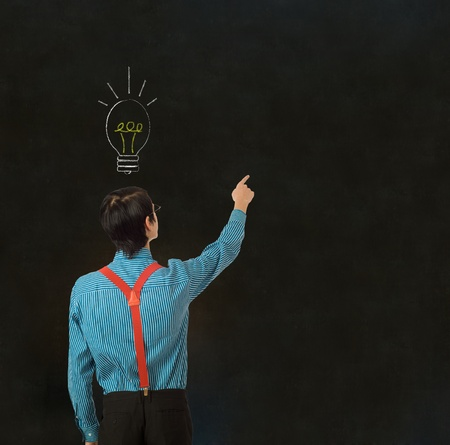 solving: Nerd geek businessman, student or teacher with bright idea chalk thinking lightbulb on blackboard background Stock Photo