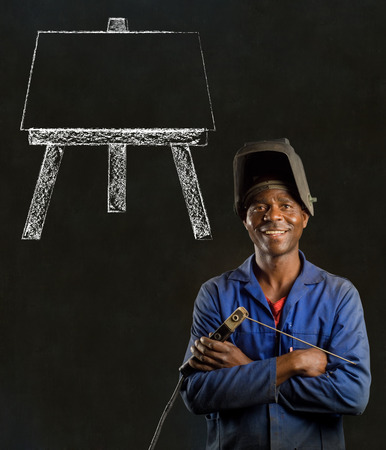 African black man industrial worker with chalk easel on blackboard background photo