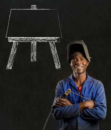 welder: African black man industrial worker with chalk easel on blackboard background Stock Photo