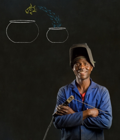 African American black man industrial worker with chalk jumping fish bowls on a blackboard background photo