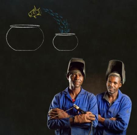 African American black men industrial workers with chalk jumping fish bowls on a blackboard background photo