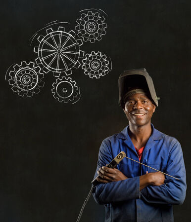 African American black man industrial worker with chalk gears on a blackboard background photo