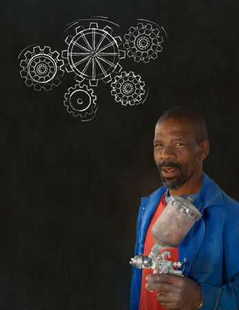 African American black man industrial worker with chalk gears on a blackboard background Stock Photo - 22841913