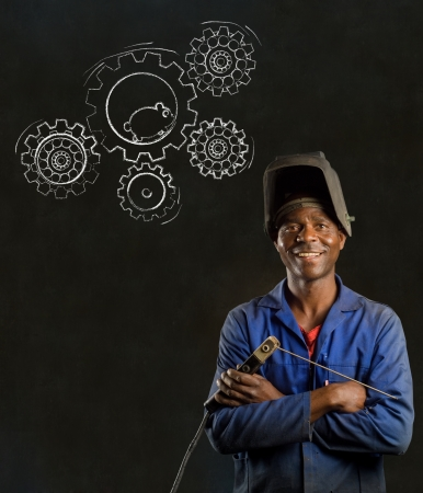 African American black man industrial worker with chalk hamster gears on a blackboard background photo