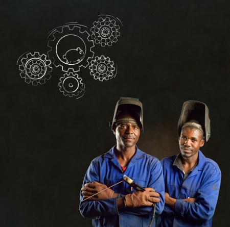 African American black men industrial workers with chalk hamster gears on a blackboard background photo