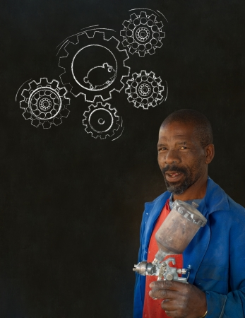 African American black man industrial worker with chalk hamster gears on a blackboard background Stock Photo - 22841920