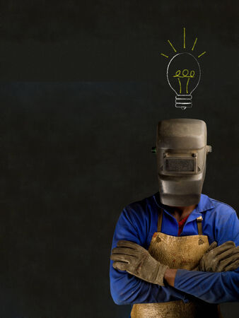 African American black man industrial worker with chalk light bulb on a blackboard background photo