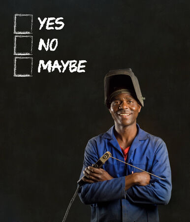 African black man industrial worker with chalk checklist on blackboard background photo