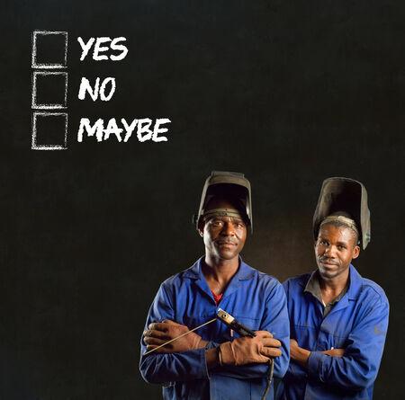 African black men industrial workers with chalk checklist on blackboard background photo