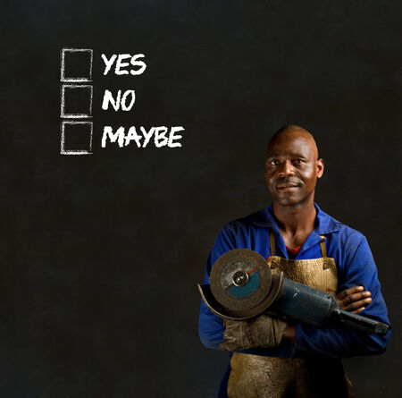 African black man industrial worker with chalk checklist on blackboard background Stock Photo - 22841927
